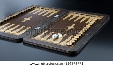 The backgammon and dice with six double