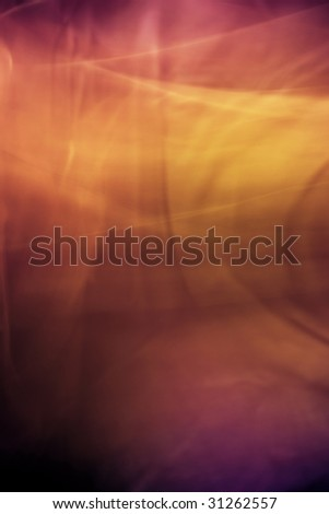 The background created by means of movement of silk fabrics on rather long shutter speed. Dark background.