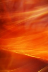 The background created by means of movement of silk fabrics on rather long shutter speed.  Fiery storm.