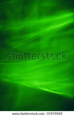 The background created by means of movement of silk fabrics on rather long shutter speed.  Green.
