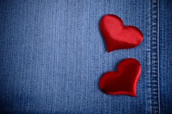 The background for Valentine's Day. Abstraction of denim and hearts of the fabric.