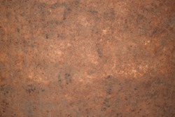 The background image of the iron sheet is rusting caused by prolonged use. There are alternate brown-red colors with some sharp spots.
