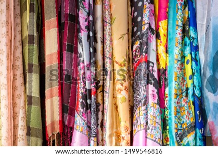 the background is formed by various fabrics with various patterns