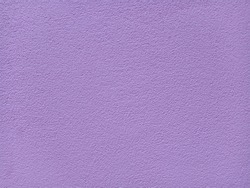 The background is made of purple colored concrete.