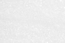 The background is white. The texture of the brilliant snow for the New Year's postcard.