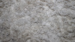 The background of a fleecy carpet, lowercase threads, the texture of a fleecy white carpet.