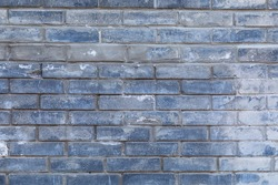 The background of a multicolor gradient painted brick wall of uneven fascia. Difference of color. Blue and brown shade of paint