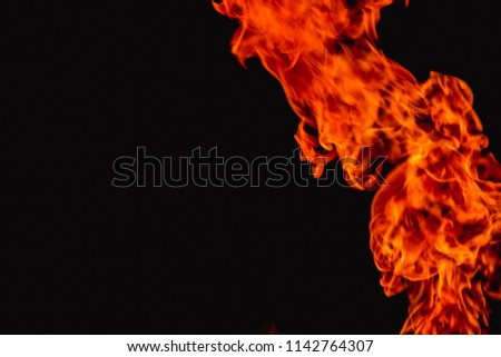 The background of the hot fire was lit up to illustrate the heat of the flame and was used for initial firefighting for residents of a condo or city. Introduction to fire and firefighting. #1142764307