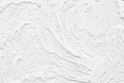 The background of the raised white wall is finished with decorative plaster. Design renovation of old housing and commercial real estate. Luxury texture.