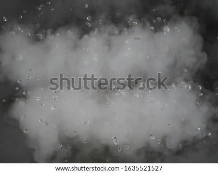 The background of water droplets and smoke.