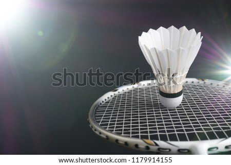 the badminton racket and shuttlecock in action in the game of sport for recreation  #1179914155