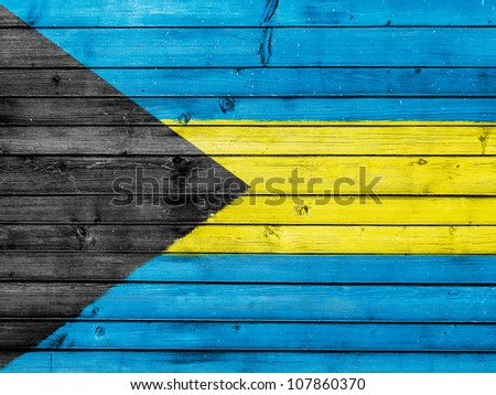 The Bahamas flag painted on wooden fence