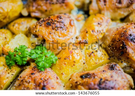 the baked chicken with potatoes, closeup