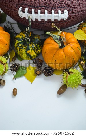 The ball for football with pumpkins, three leaves, acorn and cones on the white background. The picture is awesome for fall football game invitation card.