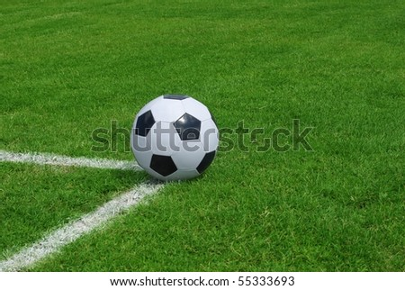 the ball in corner on background of green grass