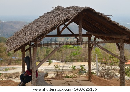 The bamboo shelters and a thatched roof for shelter and rest for a while relax after a tour and photography. #1489625156