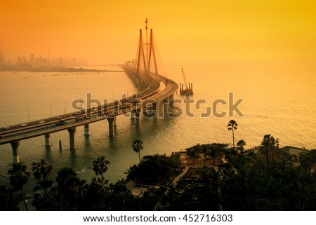 The Bandra-Worli Sea Link, also called Rajiv Gandhi Sea Link at dusk. It is a cable-stayed vehicular bridge that links Bandra in the northern suburb of Mumbai with Worli in South Mumbai.  #452716303