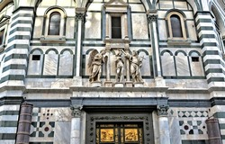 The Baptistery is one of the oldest buildings in Florence Italy. 4th century. Iconic octagonal basilica with striking marble facade, known for its bronze doors and mosaic ceiling. Italy, Florence
