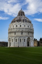 The Baptistery of St. John (Battistero di San Giovanni, 1363) at Piazza dei Miracoli (Square of Miracles) in Pisa. Baptistery is Unesco world heritage site. Pisa, Tuscany, Italy, Europe.