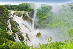 The Barron Falls - massive waterfall in Australia surrounded by tropical rainforest