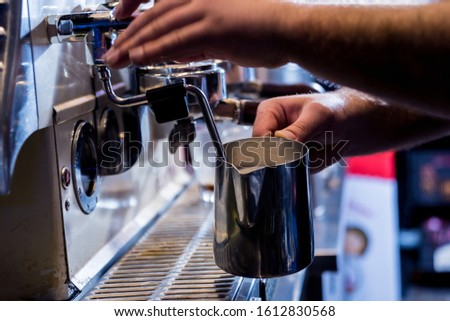 The bartender makes the coffee, cappuccino, cocoa, drink at the bar. Barista. Restaurant.