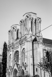 The Basilica of Notre-Dame de Nice, neo-gothic roman catholic church in Nice, Cote d'Azur, France in black and white