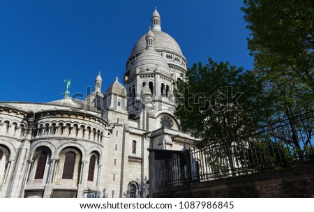 The basilica Sacre Coeur is a Roman catholic church located at the summet of the butte Montmartre , the highest point in Paris. #1087986845