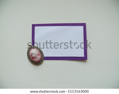 The basis for the inscriptions is white on a purple rectangle, a blank for text with a cameo #1513163000