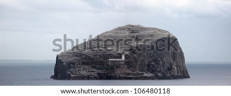 The Bass rock island and lighthouse panorama, from the east coast of Scotland