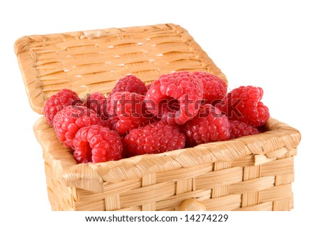 The bast-basket with a raspberry is photographed on a white background