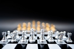 The battle chess sport game stand on chess board with dark background.Business leader concept for market target strategy.Intelligence challenge and business competition success play.Symbol of winner.