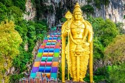 The Batu Caves Lord Murugan Statue and entrance near Kuala Lumpur Malaysia. A limestone outcrop located just north of Kuala Lumpur, Batu Caves has three main caves featuring temples and Hindu shrines