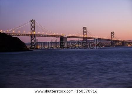 The Bay Bridge in San Francisco at dusk.
