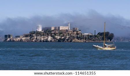 The bay in San Francisco with Alcatraz island and a sailboat passing
