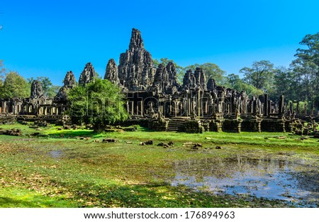The Bayon Temple is one of the most significant historical and religious sites in the Angkor Thom area. The ruins feature over one hundred huge faces carved into the towers.