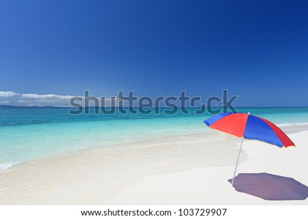 The beach and the beach umbrella of midsummer.