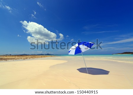 The beach and the beach umbrella of midsummer