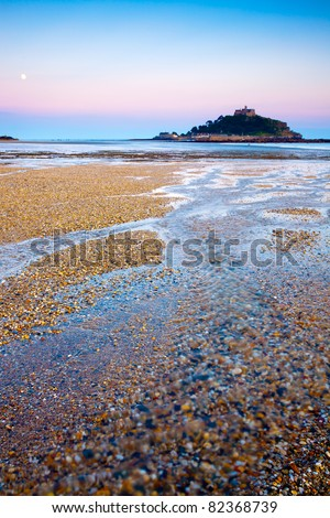 The beach at Marazion Cornwall England illuminated by a full moon.