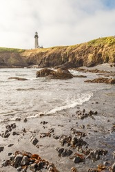 The beach below Yaquina Head Lighthouse at Pacific coast, Oregon, USA