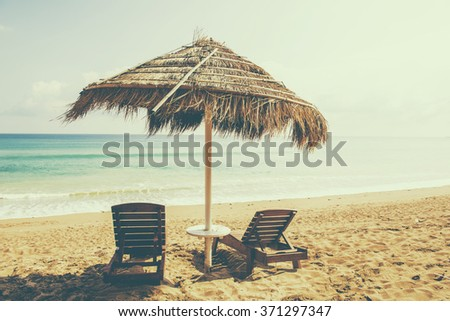 The Beach chairs and umbrella on a beautiful panoramic beach view and south china sea with copy space area #371297347