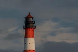 The beacon of Westerheversand with blue cloudy sky