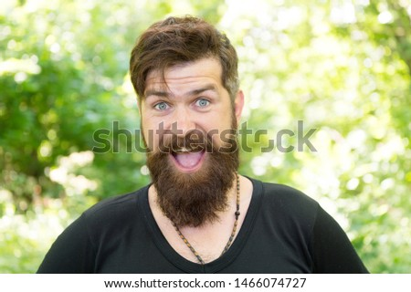 The beard with depth and texture. Bearded man smiling with stylish mustache and beard shape. Unshaven hipster with textured beard hair on summer outdoor. Happy caucasian guy with beard on nature.