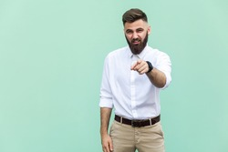 The bearded man pointing finger at camera and mockery over someone. Indoor, studio shot