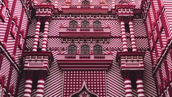 The beautiful and colorful unique architecture facade of  Jami Ul-Alfar Mosque or red masjid that painted white and red pattern, The popular islamic landmark in colombo, Sri lanka