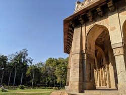 The beautiful arches of the 15th Century Tomb of Muhammad Shah in the verdant Lodhi Gardens of Delhi, India.
