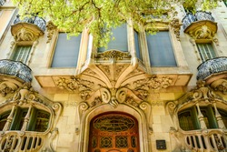 The beautiful architectural facade of the modernist house, Casa Comalat by Spanish architect Valeri i Pupurull, Barcelona, Spain