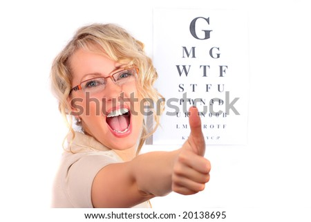 The beautiful blonde in the optical salon - stock photo
