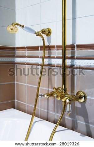The beautiful bronze faucet and white bath