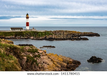 The beautiful Buchan Ness lighthouse, built in 1825, on Moray Firth Coast; Aberdeenshire, Scotland. Scottish sky above the beautiful cliffs of Moray. #1411780415