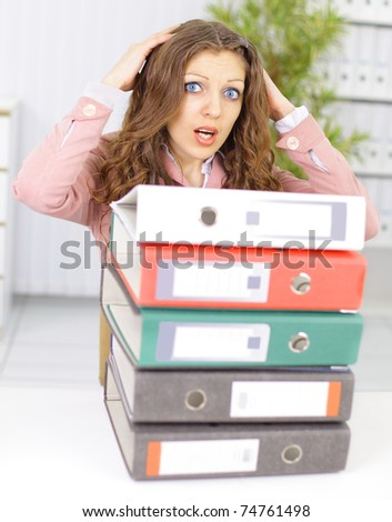 The beautiful business woman at office asks of the help - stock photo